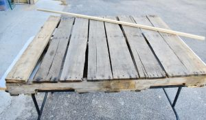 Use a straight board to mark cut lines for your pallet project - WildflowersAndWanderlust.com