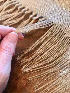 How to Make Knotted Fringe on Your Burlap Table Runner | WildflowersAndWanderlust.com