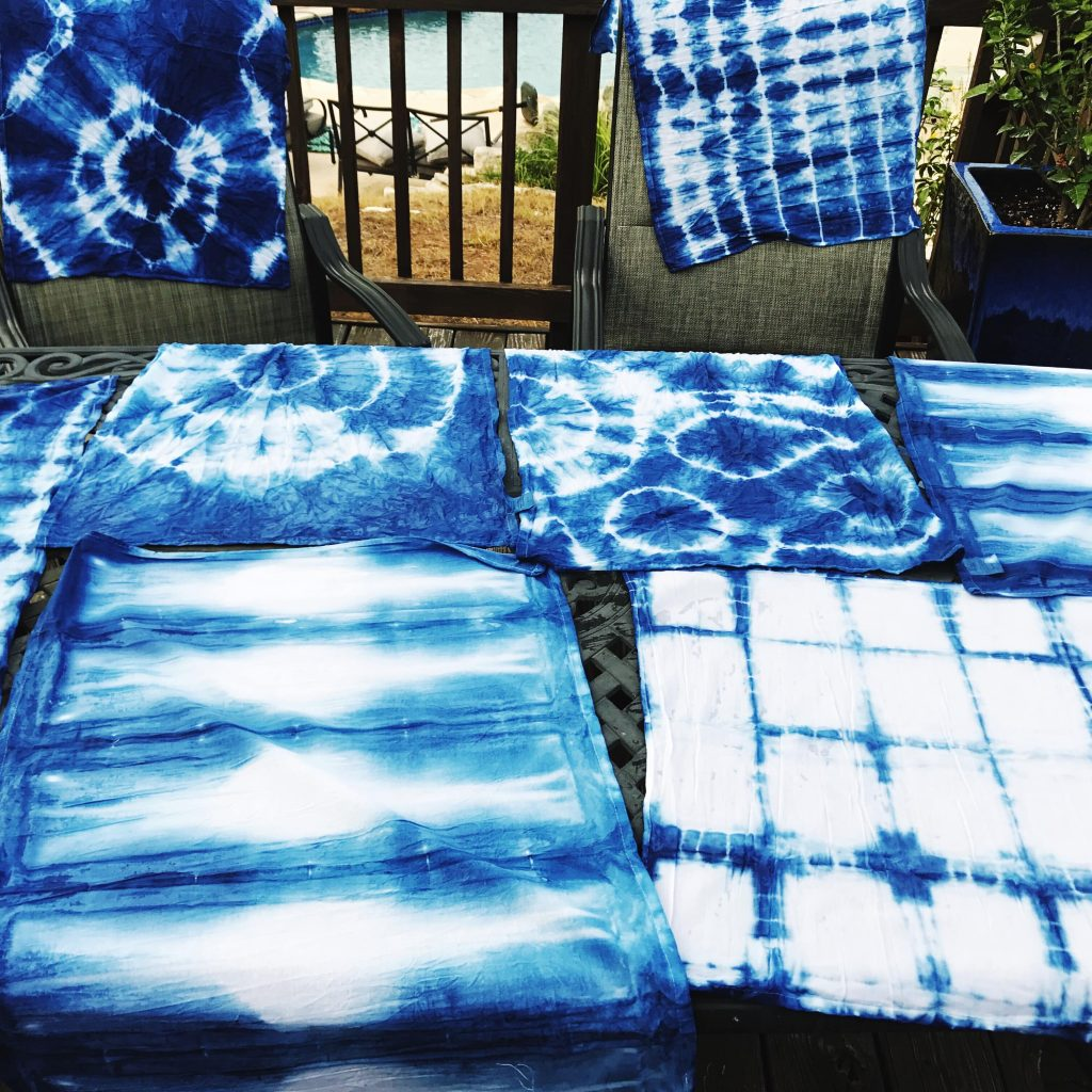 We like to lay all of our freshly dyed items outside to dry before we run them through the wash | WildflowersAndWanderlust.com