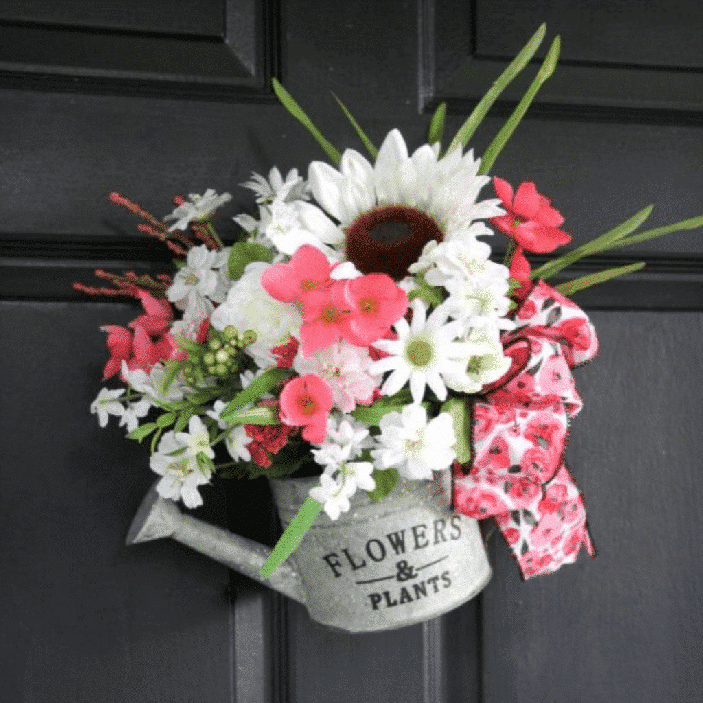 A Watering Can Wreath is beautiful front door decor for Spring | WildflowersAndWanderlust.com