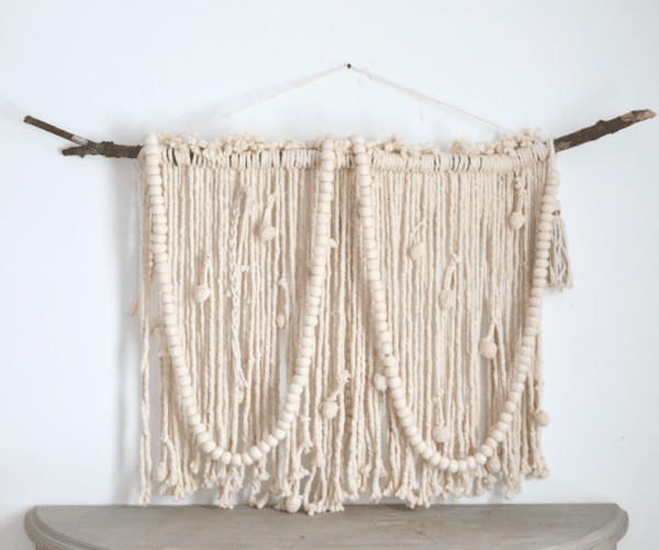 Here's a macrame wall hanging by The Nester | WildflowersAndWanderlust.com