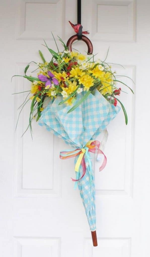 Using an umbrella or parasol is a great base for a front door wreath | WildflowersAndWanderlust.com