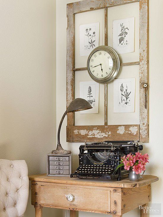 Using an old window as a frame is a great way to display art via bhg.com as featured on WildflowersAndWanderlust.com