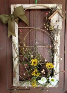 Using an old window and florals is a great way to decorate your front door for spring | WildflowersAndWanderlust.com