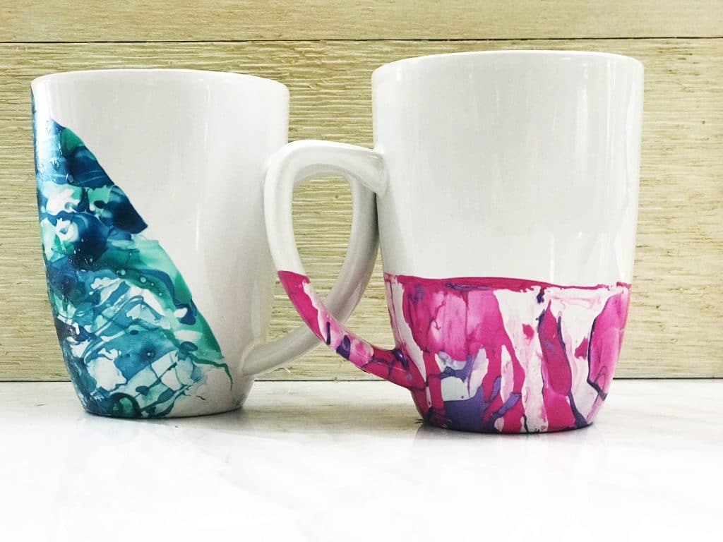 You can make these watercolor mugs using inexpensive mugs and nail polish just follow our tips WildflowersAndWanderlust.com