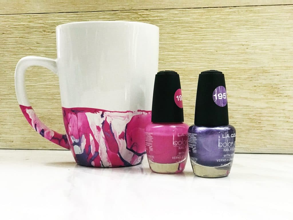 We made this marble mug using pink and purple nail polish WildflowersAndWanderlust.com