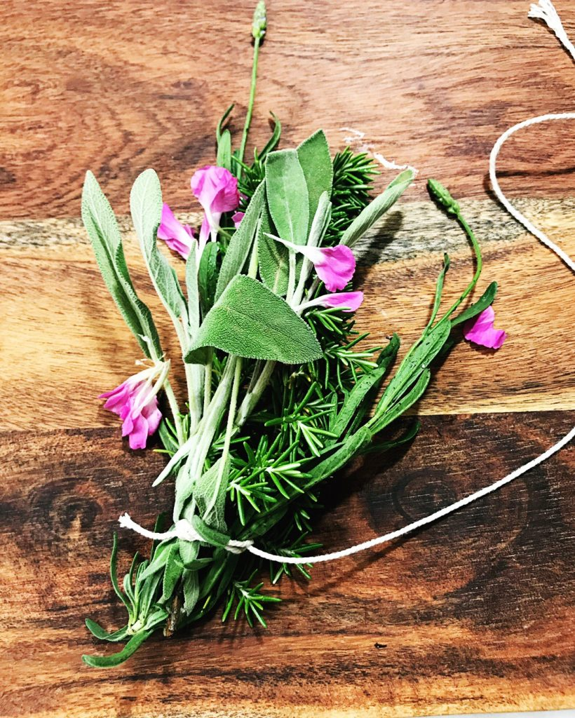 Start at the bottom of your bundle and criss cross your strings all the way to the top to make a smudge stick | WildflowersAndWanderlust.com