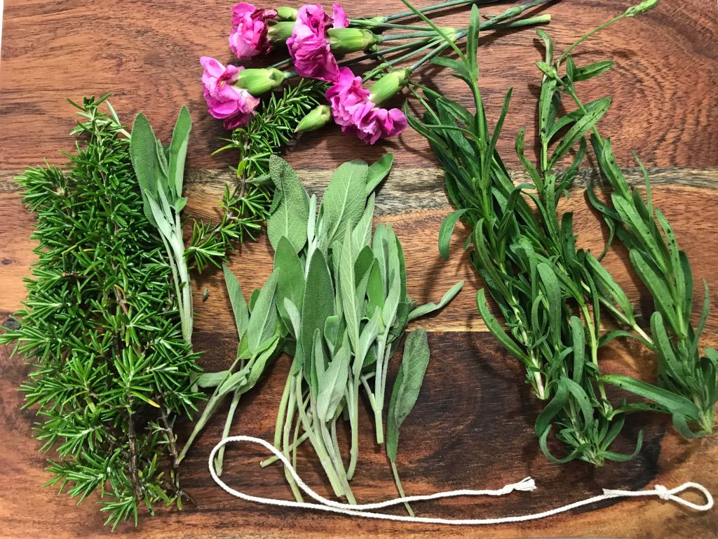 We used sage, lavender, rosemary and some carnations to make our smudge sticks for spring | WildflowersAndWanderlust.com