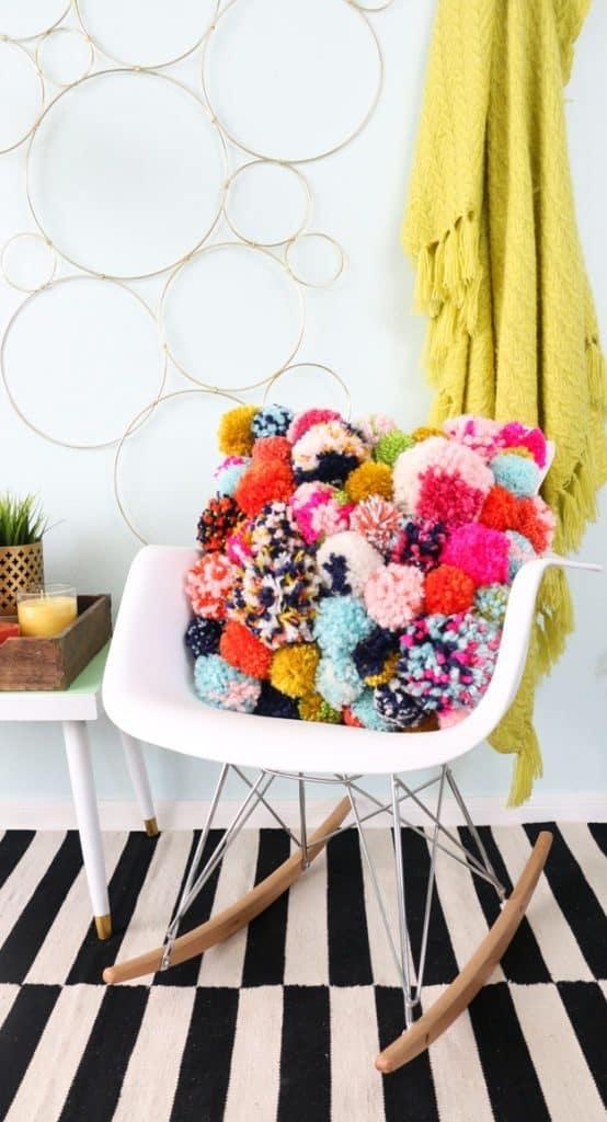 Make a pom pom pillow to sell at a craft fair WildflowersAndWanderlust.com
