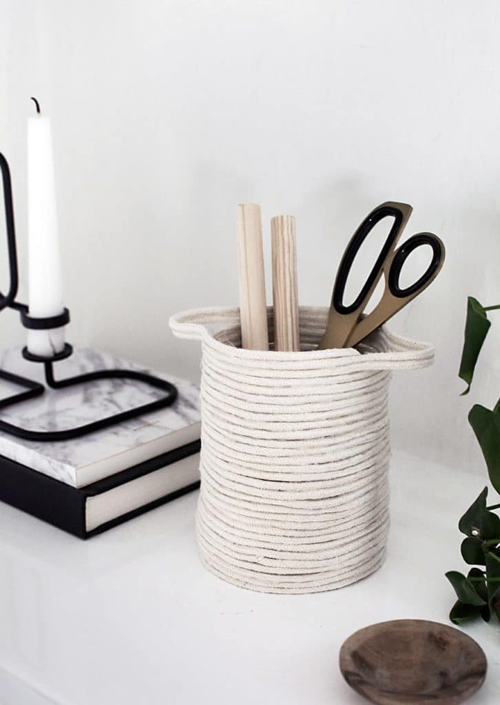 A rope vase is a DIY craft that you can make and sell for profit by Homey Oh My and featured on WildflowersAndWanderlust.com