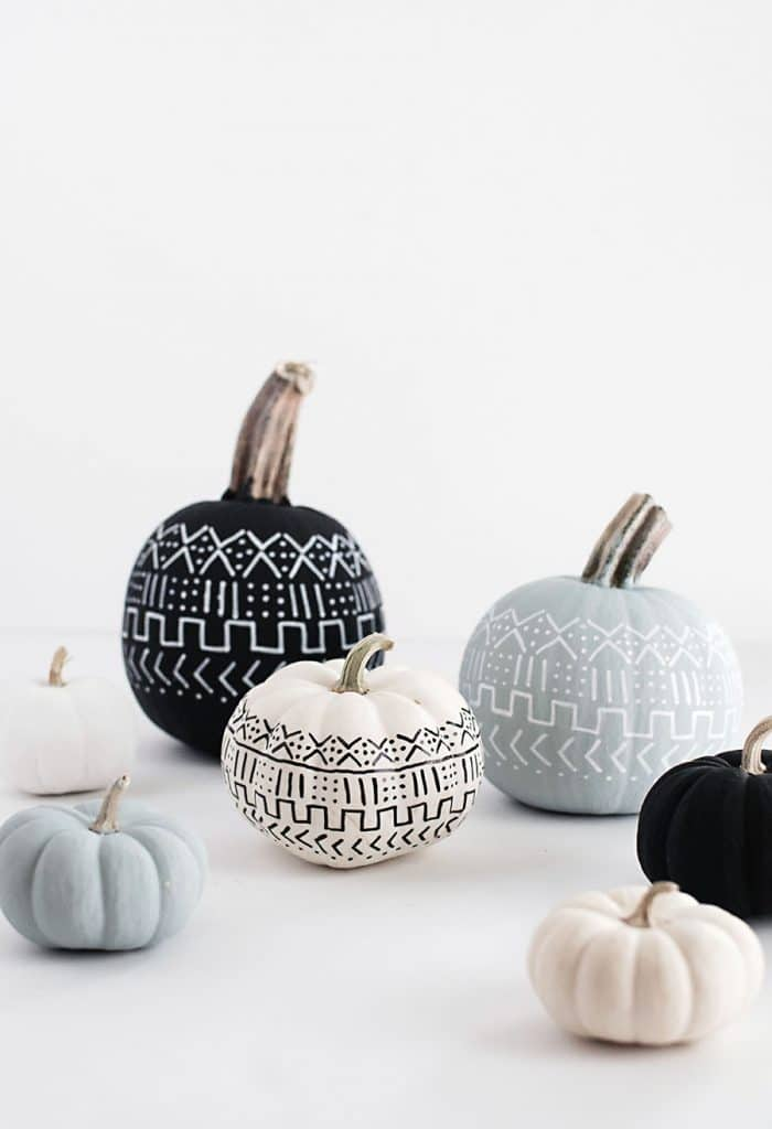 Halloween pumpkins that have a pattern inspired by MudCloth