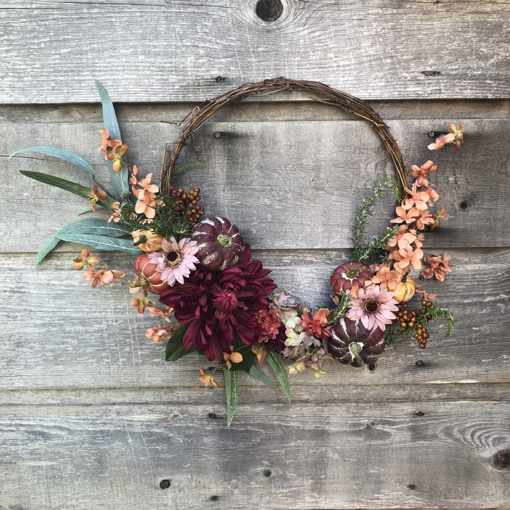 An easy to make fall wreath featuring peony's WildflowersAndWanderlust.com