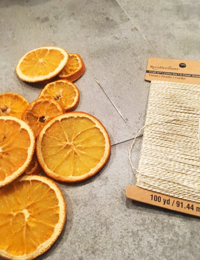 Use a large needle and twine or wire to make an orange slice garland  WildflowersAndWanderlust.com