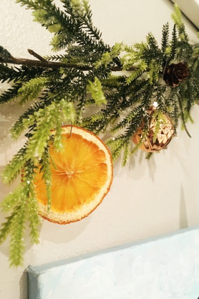 We made these festive dried orange slices to use in all our Christmas decor - garland, wreaths, ornaments and gift tags. WildflowersAndWanderlust.com