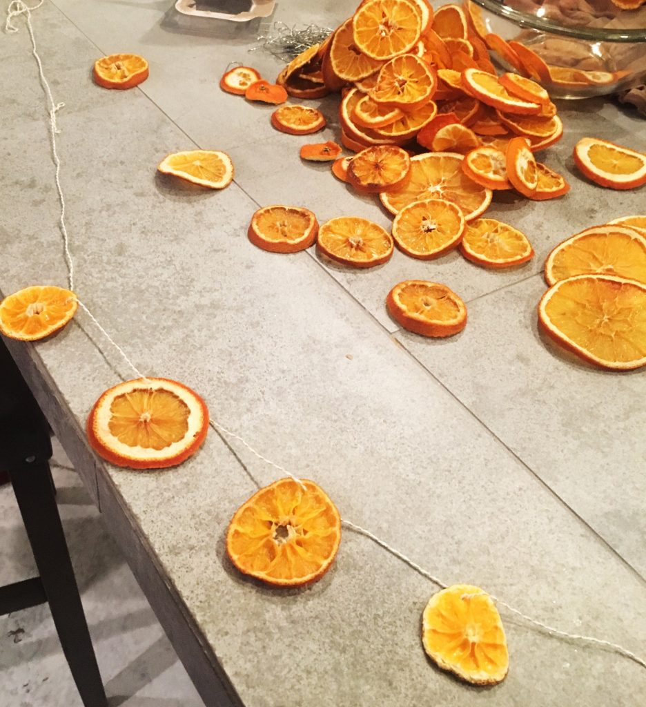 Be sure to string your orange slice garland close to the rind so it will stay secure - WildflowersAndWanderlust.com