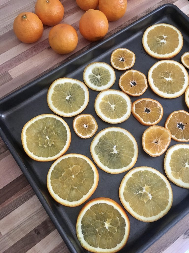 Don't overlap your orange slices when you get ready to bake them, leave a little bit of space around them.  WildflowersAndWanderlust.com