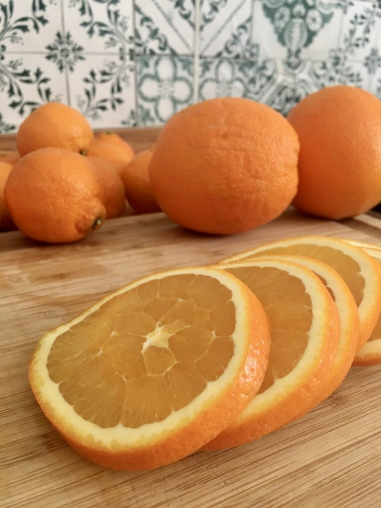 One large orange should give you around 7-8 slices to use for a garland or wreath.  WildflowersAndWanderlust.com