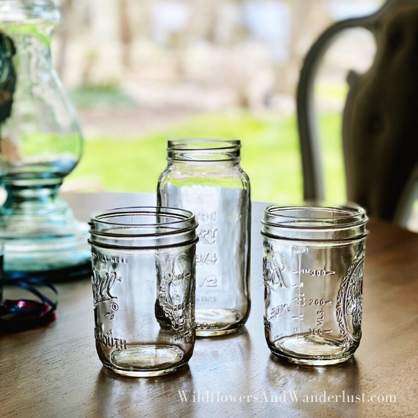 Reusing mason jars or any other clear jars is a great way to make an oil lamp WildflowersAndWanderlust.com