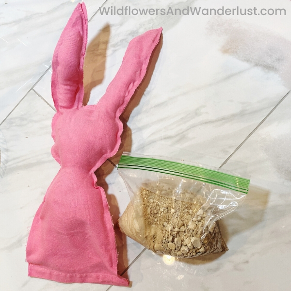 Use something heavy for the base of your bunny so he has some weight to stand on his own.  Sand or rice work best.  WildflowersAndWanderlust.com