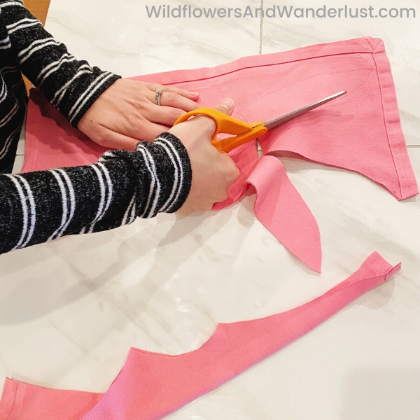 Fold your napkin in half and cut our your pattern.  WildflowersAndWanderlust.com
