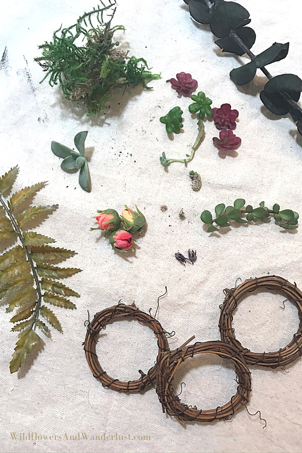 You'll need mini wreath forms and smaller flowers to create your mini wreaths.