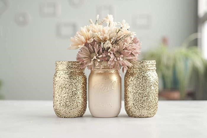 Glitter and painted centerpieces for a spring mason jars craft.