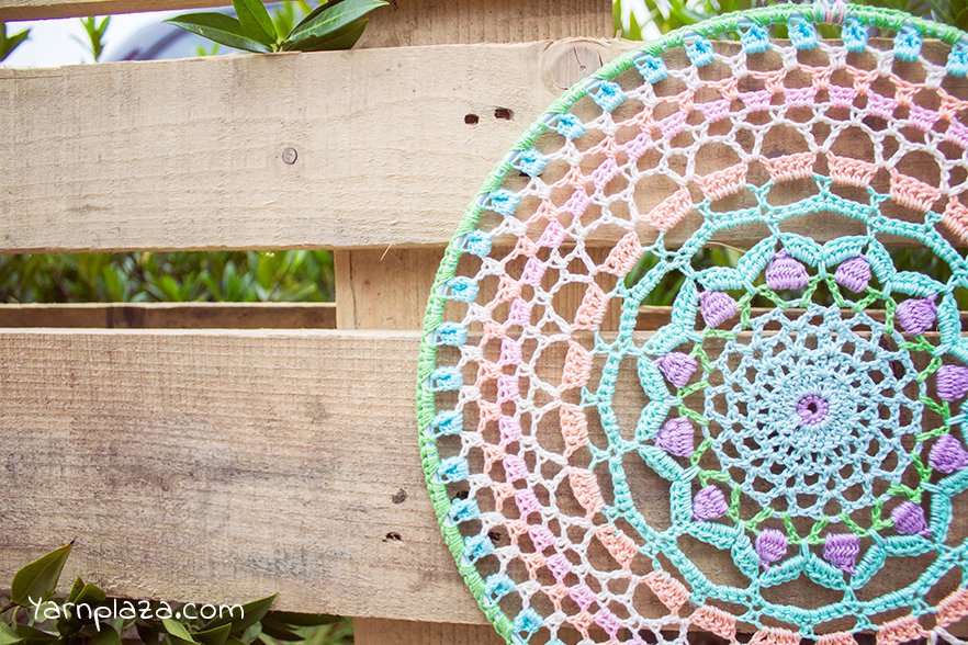 Here's a beautiful dreamcatcher pattern that you can DIY from Yarn Plaza.